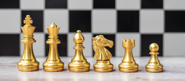 Gold chess figure team (king, queen, bishop, knight, rook and pawn) on chessboard against opponent during battle. strategy, success, management, business planning, tactic, politic and leader concept