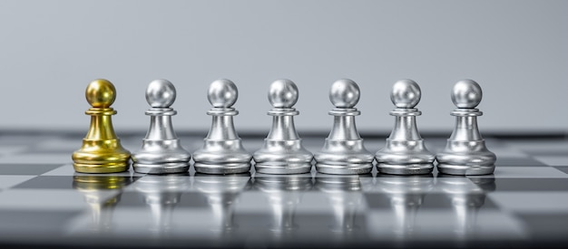 Gold chess pawn figure stand out from the crowd on chessboard background.