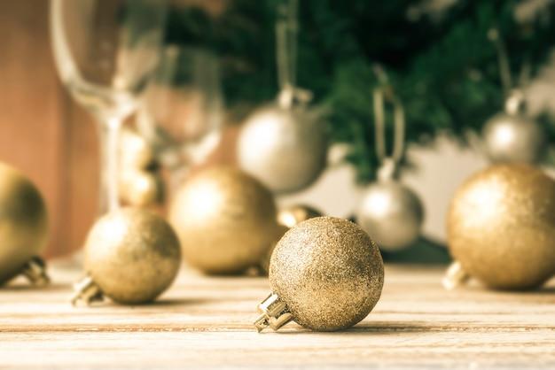 Gold christmas ball on wood table