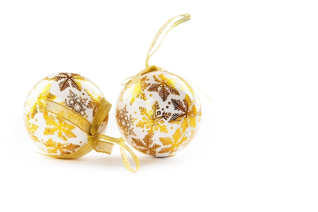 Gold christmas balls isolated on a white
