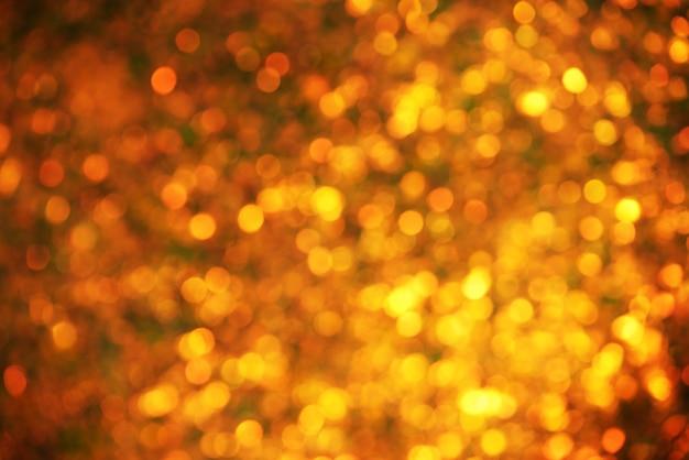 Золотой фон рождественские огни. размытие боке. абстрактный размытый светлый фон.