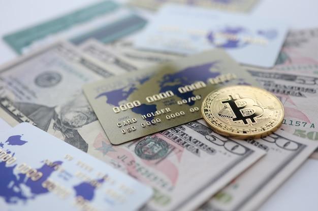 Gold coin bitcoin closeup lie on table