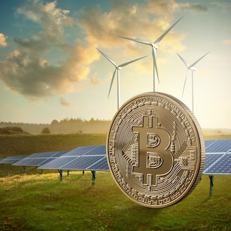Gold coin bitcoin on a green field against the sky and solar panels. eco crypto and ico, mining concept.