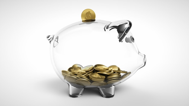 Gold coin falling into a glass piggy bank