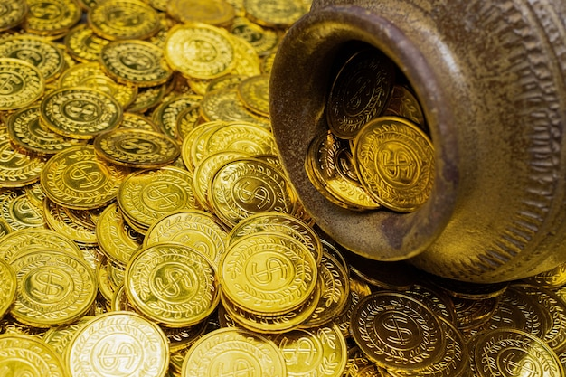 Gold coin in treasure old clay pot on a pile of gold coins
