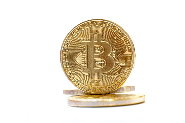 Gold coins bitcoin on white