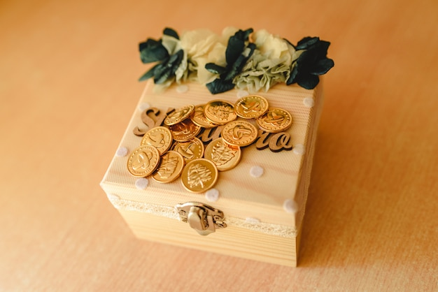 Gold coins used in the liturgy of christian marriage in spain.