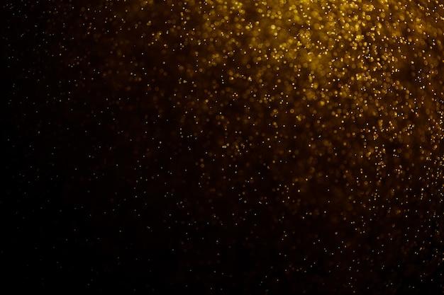 ゴールド色のボケ味の抽象的な背景