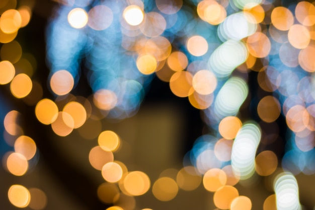 Gold color bokeh elegant abstract background with bokeh defocused lights