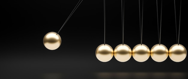 Gold-colored newton pendulum on a black background.