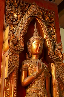 Gold colored wooden sculpture in the ancient temple, ayutthaya historical park, thailand