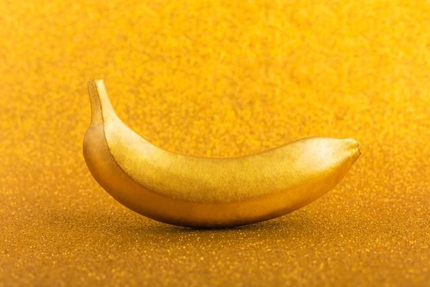 Gold colour food, golden banana. trendy tropical creative concept