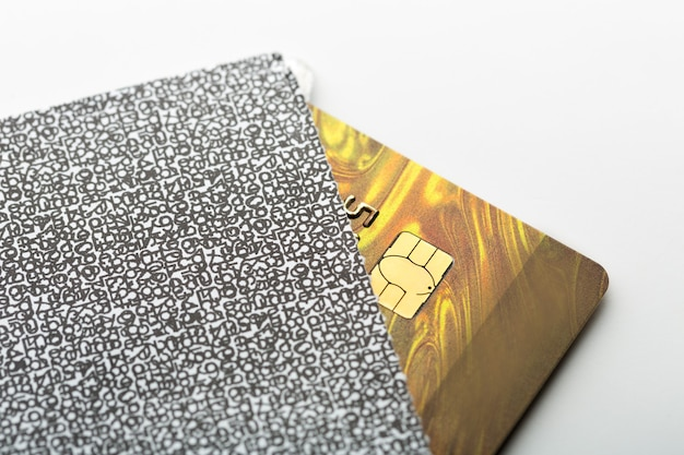 Gold credit card in the envelope on a white table
