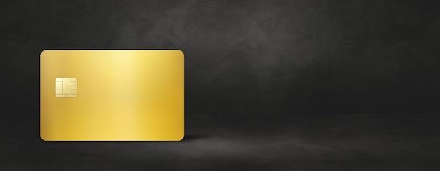Gold credit card template on a black concrete background banner. 3d illustration