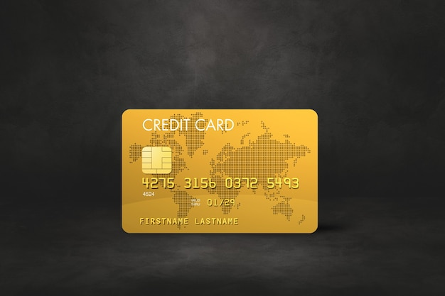 Gold credit card template on a black concrete.
