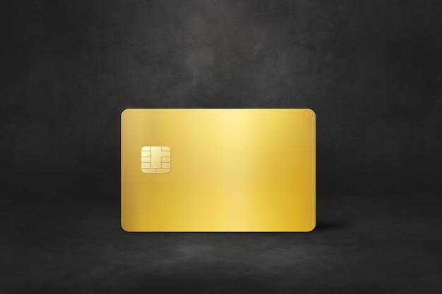 Шаблон золотой кредитной карты на черном бетоне