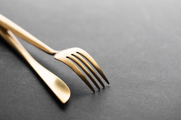 Gold cutlery set on black