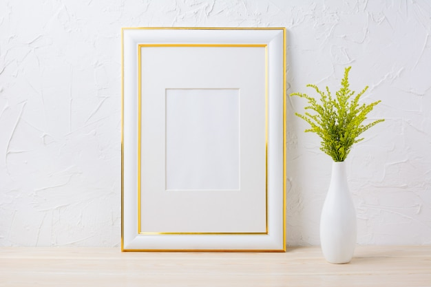 Gold decorated frame mockup with ornamental grass in exquisite vase