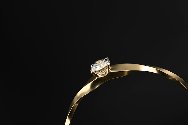 Gold diamond ring isolated on black background with copy space 3d rendering