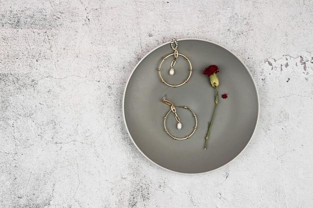 Gold earrings in a plate