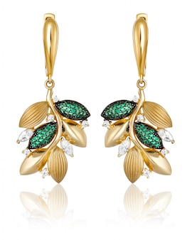 Gold earrings with green gems