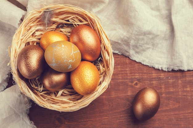 Gold easter eggs on wooden