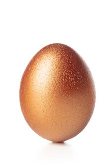 Gold egg isolated on white