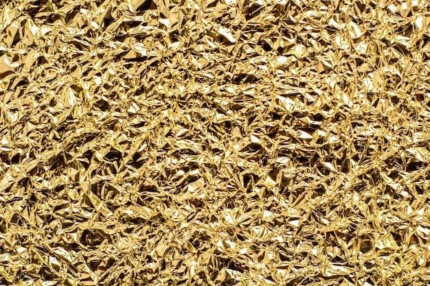 Золотая фольга абстрактная текстура и фон