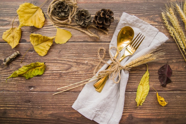 Gold fork and spoon on table