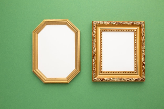 Gold frame on green background with place for your text. high quality photo