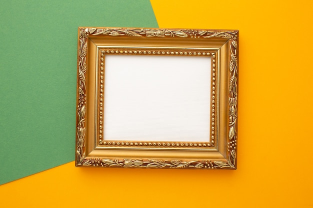 Gold frame on green and orange background with place for your text. high quality photo