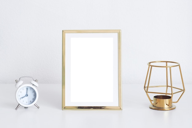 Gold frame with alarm clock and decoration