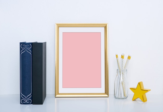 Gold frame with vase and object for interior decoration