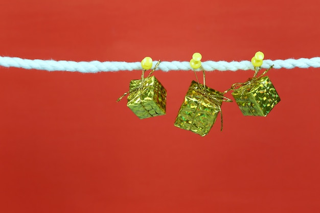 Gold gift box hang on the clothesline.