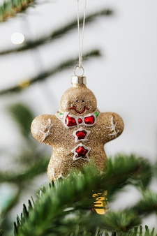 Gold gingerbread man on a christmas tree