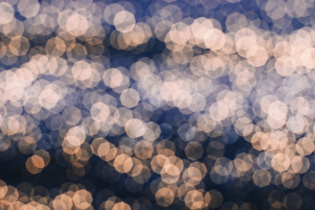 Gold glare on dark blue background