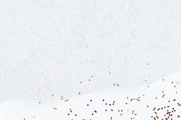 Glitter oro su sfondo bianco astratto