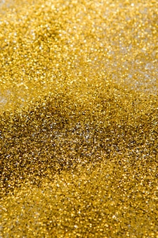 Gold glitter background, bokeh