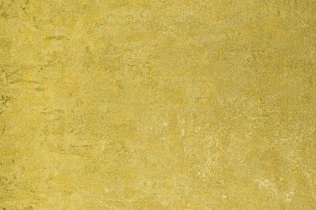 ゴールドのキラキラ背景スパークリングシャイニーラッピングペーパーテクスチャ