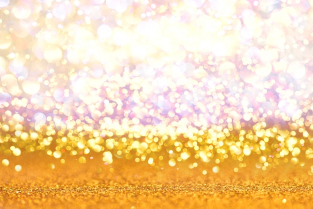 Gold glitter lights texture bokeh abstract background. defocused
