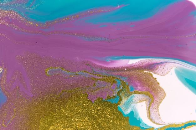 液体アクリル背景大理石の青と紫の抽象上のゴールドラメ
