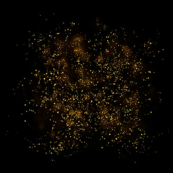Gold glitter particles lights and bokeh on a black background.