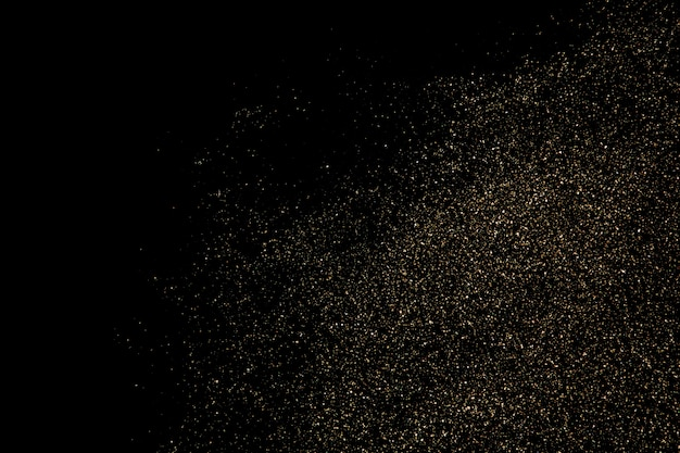 Gold glitter particles texture isolated on black background
