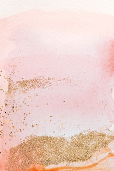 Gold glitter on pink watercolor background