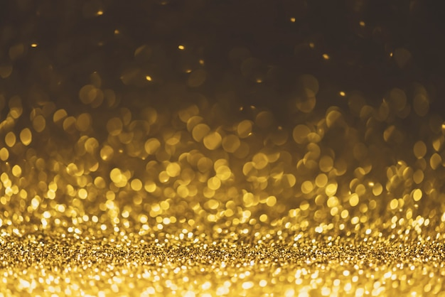 Gold glitter sparkle lights background. defocused glitter abstract twinkly light and shiny
