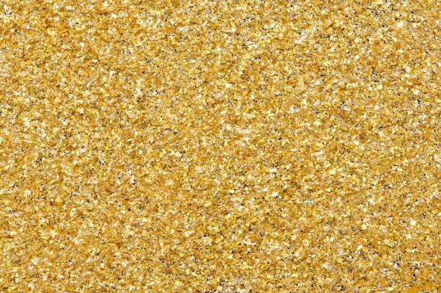 ゴールドのキラキラテクスチャの輝きの背景