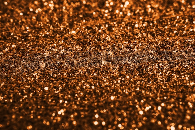 Gold glitter texture sparkling shiny wrapping paper background for christmas holiday wallpaper decoration, greeting and wedding invitation card design element, xmas abstract background with copy space
