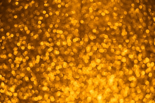 Gold glitter vintage lights background. blurred christmas abstract texture. defocused.