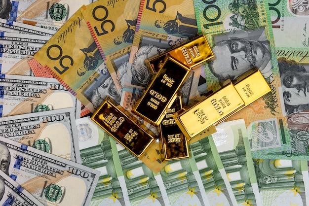 Gold ingots on american, australian dollars and euro