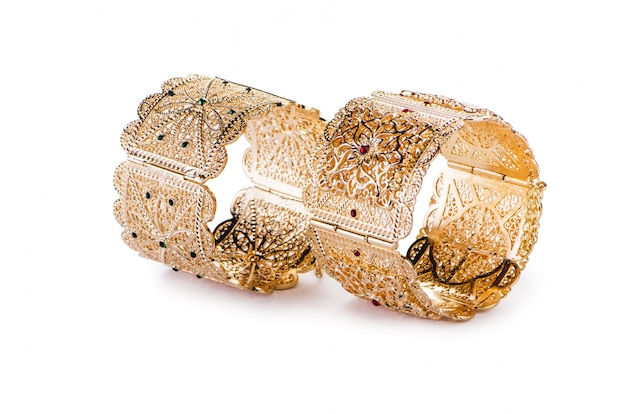 The gold jewellery ring isolated on the white background